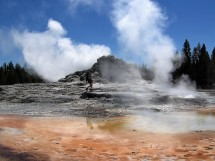 Castle Geyser in Yellowstone. (That's a park researcher, not a tourist.)