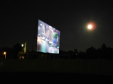 Moon over drive-in.