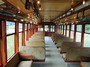 On some trolleys, the seat backs can be shifted to face forward or backward. At the end of the line, the operator would switch them so passengers would face forward on the return trip.