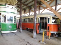 This orange streetcar served in Boston until 1982. It is similar to the older style trolleys I rode on the Green Line. To the left is one of the museum's double-decker trolleys.