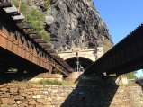 Mile 60.7: Trains often pass through the B&O Railroad tunnel and across the bridges at Harpers Ferry, which is on the opposite side of the Potomac from the canal. To reach town, you climb a wide spiral staircase here and take the walkway on one of the bridges.