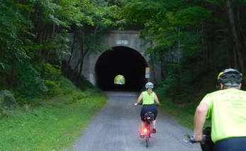 Our first ride on the GAP trail covered about 17 miles from Frostburg to just beyond Meyersdale, Pennsylvania, a stretch that includes a series of tunnels, bridges, viaducts, and other notable features. Here we head into the Borden Tunnel. About 900 feet in length, the unlit tunnel is much longer and darker than it looks.