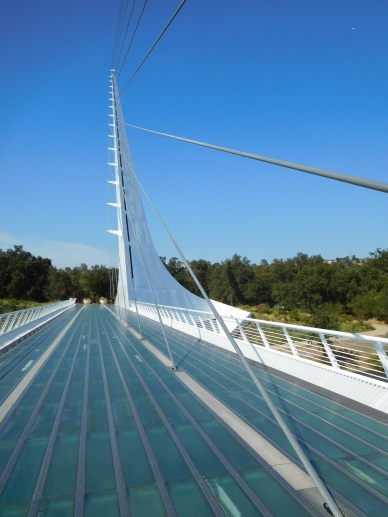 My sister Deborah took me to Redding in north-central California to see the artfully designed Sundial Bridge. This pedestrian bridge with its glass deck spans the Sacramento River. The bridge's suspension cables are held up by a single pylon, which also serves as the shadow-casting gnomon of a large sundial.