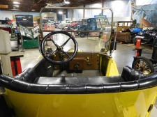 The view from the backseat of a yellow 1913 Ford Model T touring car, one of a couple of vehicles you can climb aboard. Beginning in 1914, Ford began offering the Model T only in black, because it was less expensive and dried faster than other colors, thus speeding up assembly.