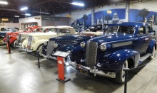Automotive designs reached new heights of elegance in the 1930s. In the foreground is a 1937 Cadillac Series 60 Sedan. Next to it is a 1936 Ford Roadster.