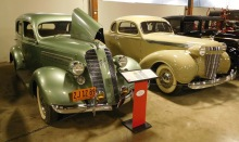 The paint jobs alone are stunning: here a 1936 Graham 110 Supercharged Sedan (left) and a 1937 Chrysler Imperial Business Coupe.