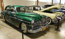 This striking green 1949 Chrysler DeSoto Carryall Sedan introduced a feature now common in cars today: a fold-down rear seat that allowed you to load long objects into the trunk.