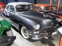 My brother still remembers our parents' first car: a Kaiser Henry J (named after the car company's co-founder Henry J. Kaiser). I asked a museum docent if he knew about that model, and he pointed me to this 1953 Kaiser Manhattan, the top-of-line version of our old family car.