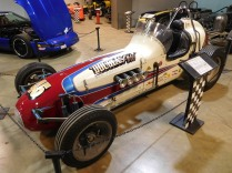 """The museum displays several racecars. This 1960 Indianapolis-Type """"Champ Car"""" is built for dirt track racing. It is similar to the sprint cars I used to watch racing at our local county fair."""