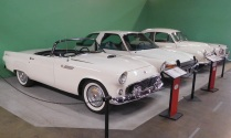 This study in white includes a 1955 Ford Thunderbird convertible. Ford's answer to Chevy's Corvette sports car, the Thunderbird proved very popular. It was sporty and stylish but also practical and comfortable.