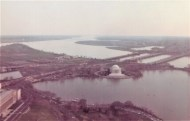 The view south over the Tidal Basin toward the Jefferson Memorial and the Potomac River. Washington National Airport is on the opposite side of the river in the distance. This view looks much the same today.
