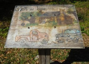 This handmade sign marks the site of an old settlement.