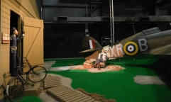A Royal Air Force pilot relaxes by his plane while he awaits the call to action during the Battle of Britain.