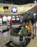 A topside gun turret and a ball turret are displayed near the airplane. To squeeze into the tiny ball turret, the gunner had to wrap himself in a fetal position around the machine gun.