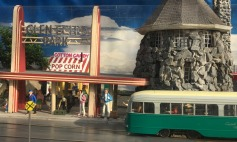The trolley pulls up to park entrance. The historic Art Deco style Glen Echo Park sign has been restored. The stone tower, the only surviving building from the Chautauqua, now houses an art galley and studio.