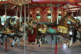 The carousel was built by master carousel maker Charles Looff in 1908. Many of the horses are even older, some dating from about 1885.