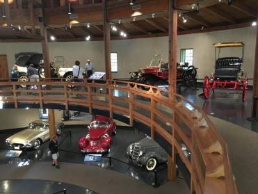 About two dozen vehicles are displayed on two levels in the round barn.