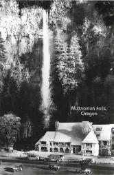 Multnomah Falls and Lodge in Oregon's Columbia River Gorge in 1930. Except for a footbridge that now crosses in front of the base of the falls (and the vehicles), this view hasn't much.
