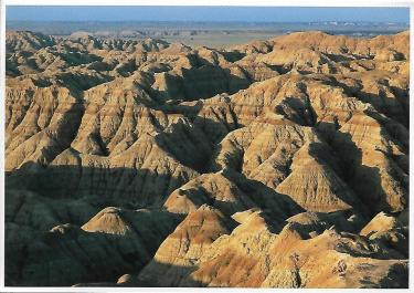 Badlands National Park in South Dakota, a region of eroded layers of siltstone and sandstone. The bands of color are caused by varying amounts of iron.