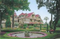 The Winchester Mystery House in San Jose, California. An heir to the Winchester gun fortune bought an 8-room farm house in 1886 and spent the next 36 years adding on to it. The 160-room mansion contains many architectural quirks, like stairways and doors that don't lead anywhere.