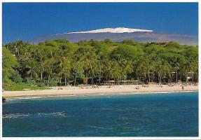 The Kohala Coast on the Big Island of Hawaii. Snowcapped Mauna Kea in the background rises nearly 14,000 feet above sea level. From its ocean base, it rises 33,500 feet, making it by that measure the tallest mountain on earth.