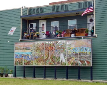 An unexpected sight in Point Marion: a billboard-size stained glass mural.